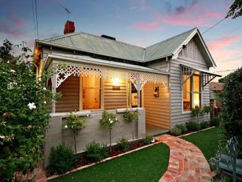 Corrugated iron edwardian house exterior with porch & landscaped garden - House Facade photo 450221