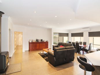 Dining-living living room using brown colours with floorboards & bi-fold doors - Living Area photo 1005166