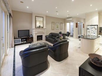 Open plan living room using beige colours with leather & fireplace - Living Area photo 1087227