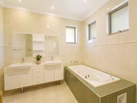 Mosaic tiles around bath