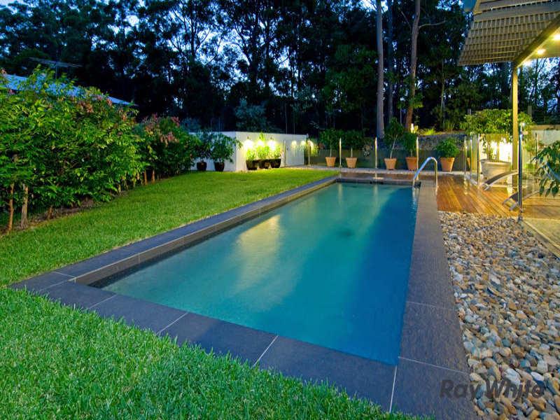 swim spa pool design using pebbles with verandah  u0026 hedging