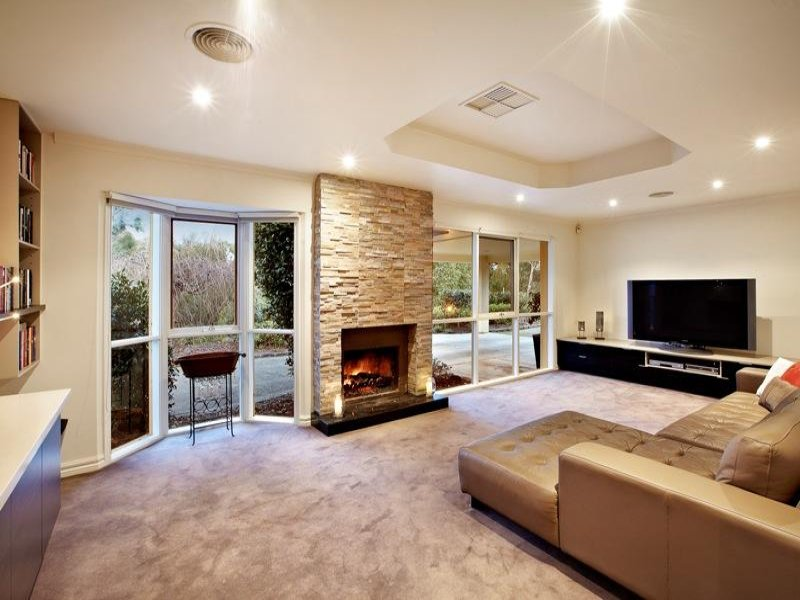 Open plan living room using brown colours with stone for Wallpaper for living area