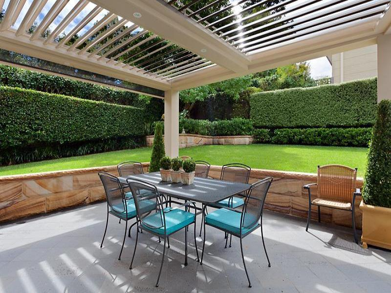 Outdoor living design with pergola from a real australian for Small outdoor patio areas