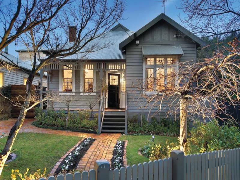 Corrugated Iron Edwardian House Exterior With Picket Fence