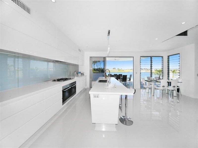 Modern Island Kitchen Design Using Polished Concrete