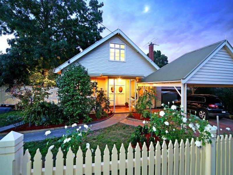 low maintenance garden design using grass with verandah  u0026 decorative lighting