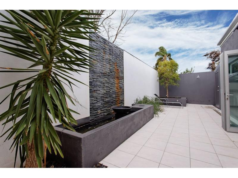 Low Maintenance Garden Design Using Slate With Fish Pond