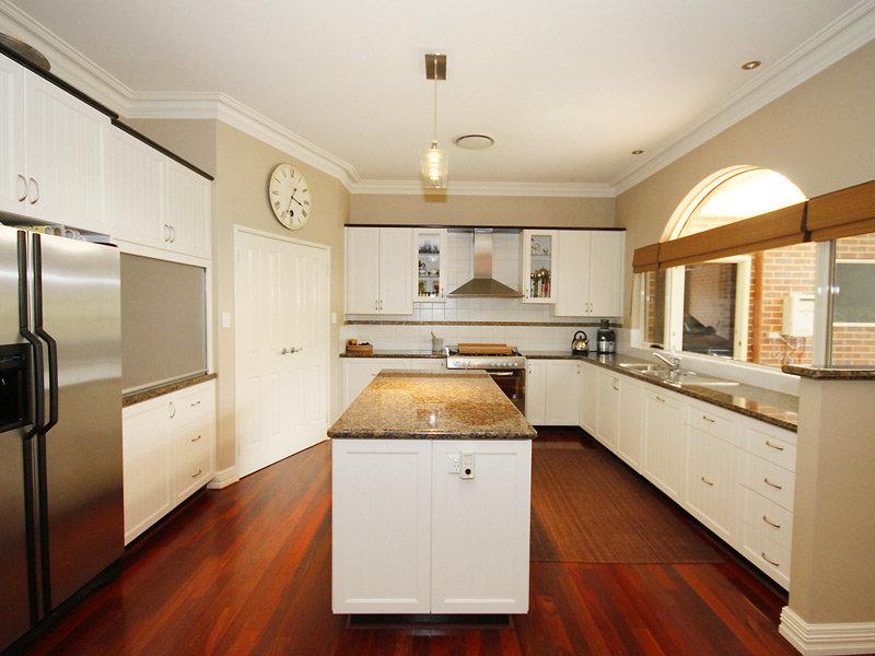Modern island kitchen design using exposed brick kitchen photo