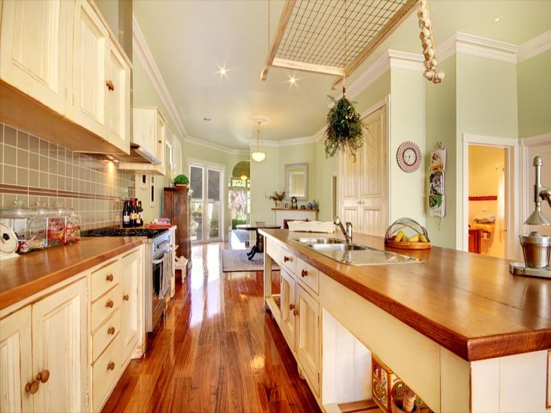 Country Galley Kitchen Design Using Hardwood