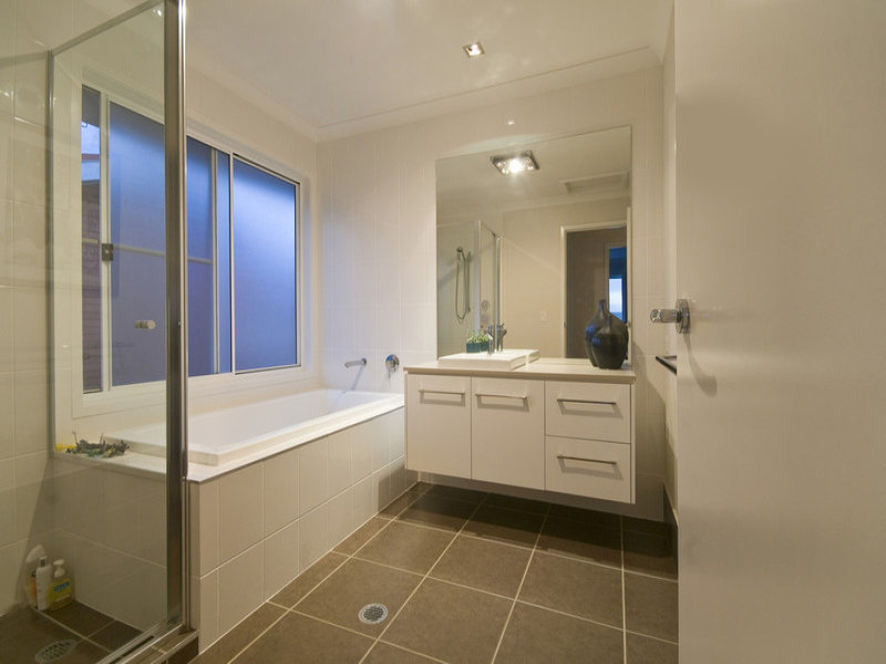 Modern bathroom design with bi fold windows using ceramic