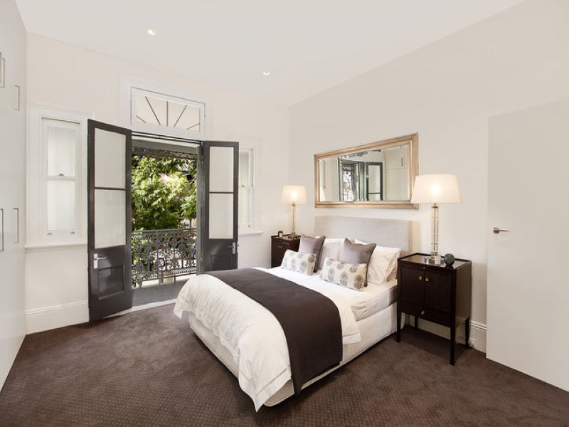 Modern bedroom design idea with carpet & french doors ...