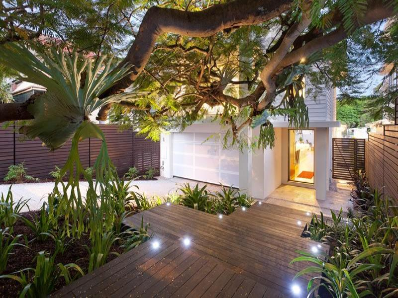 Modern garden design using timber with deck decorative for Garden lighting designs