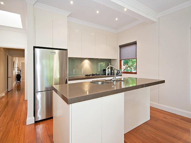 Modern island kitchen design using floorboards - Kitchen Photo 434983