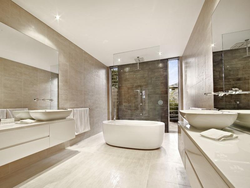 Ceramic in a bathroom design from an australian home for Home restroom ideas
