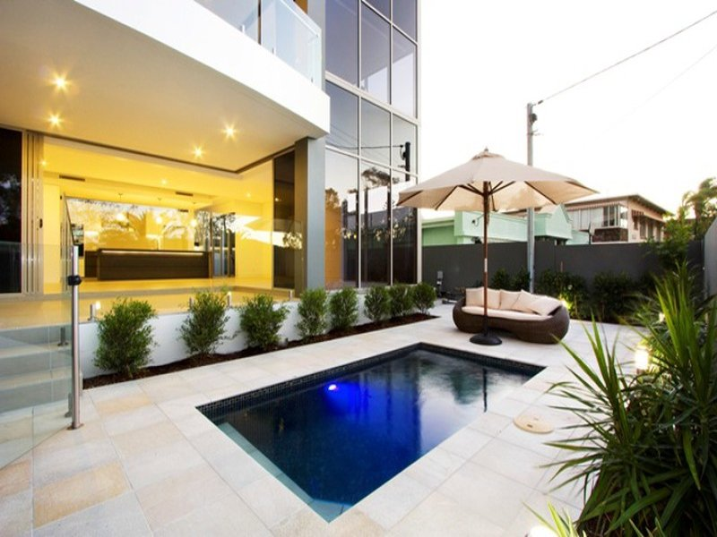 multi level outdoor living design with pool decorative