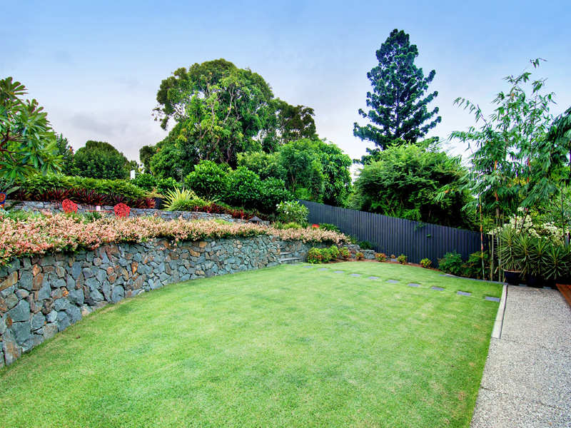 Low Maintenance Garden Design Using Cane With Bbq Area