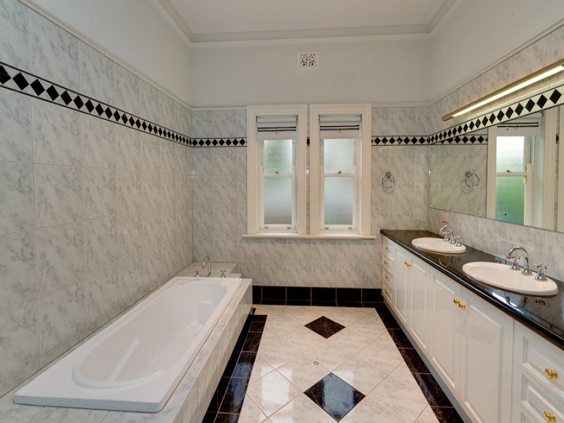 Art Deco Bathroom Design With Recessed Bath Using Frosted