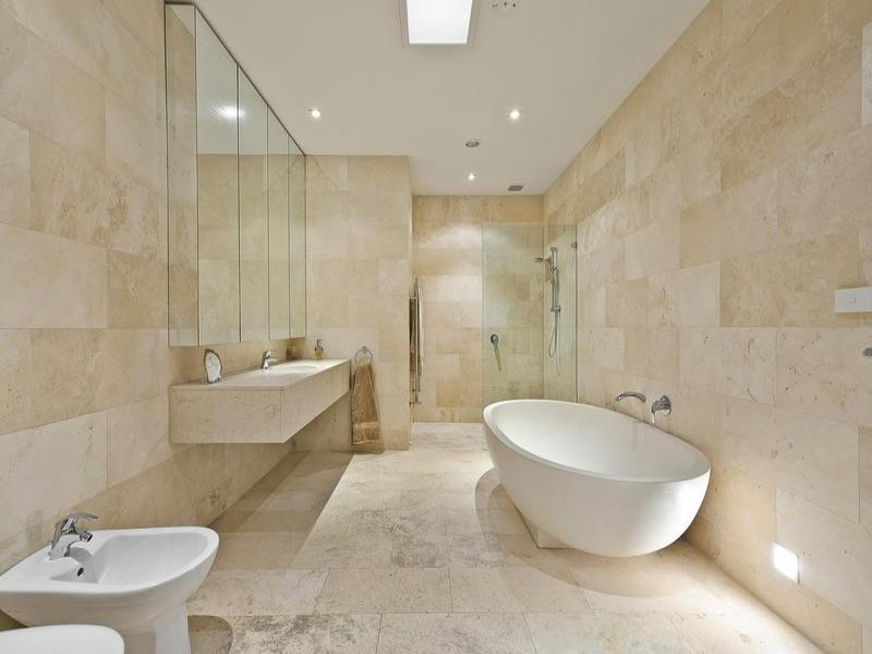 Classic bathroom design with corner bath using tiles for Bathroom designs classic
