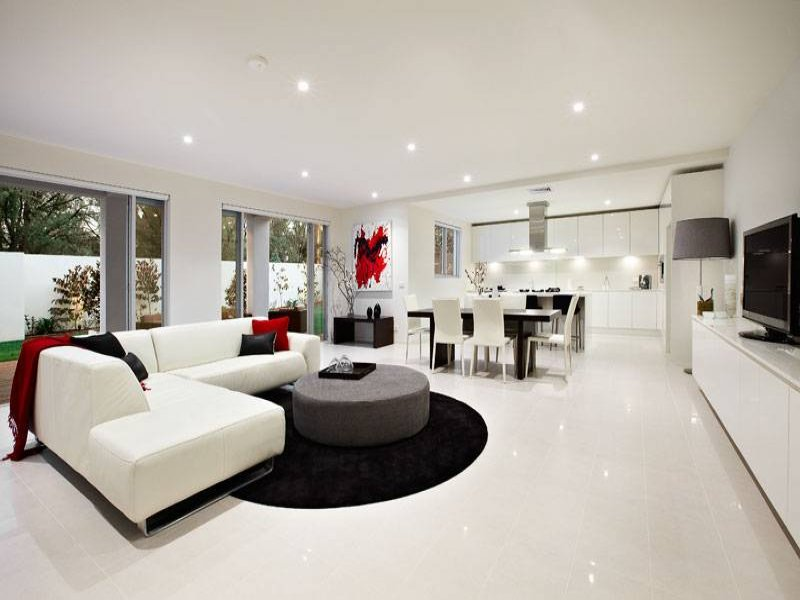 Open plan living room using black colours with tiles for Living area ideas