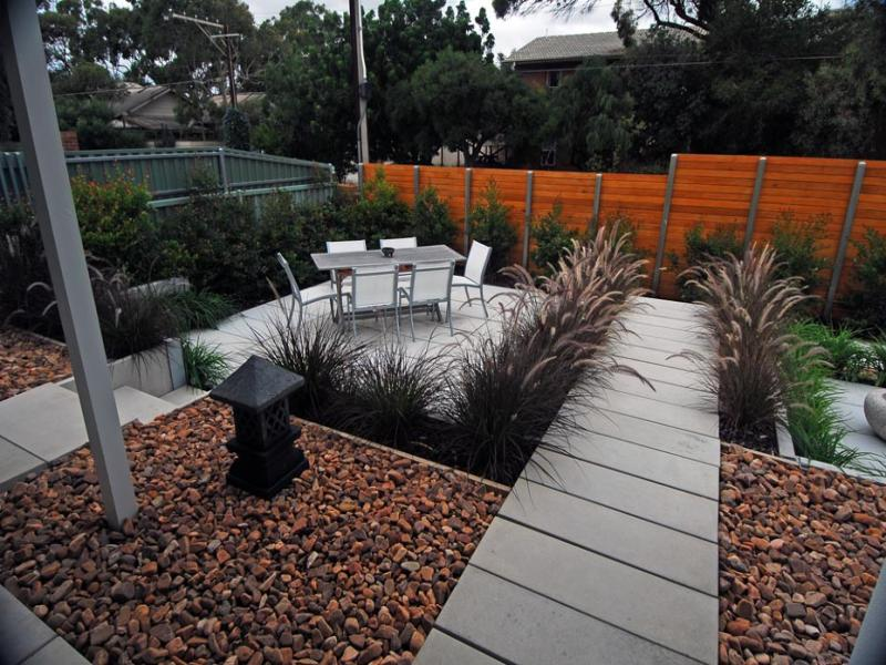 Low maintenance garden design using pavers with outdoor for Low maintenance sloping garden ideas