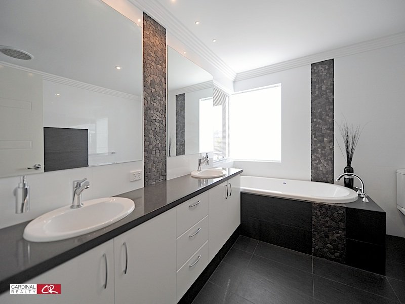 modern bathroom design with spa bath using polished