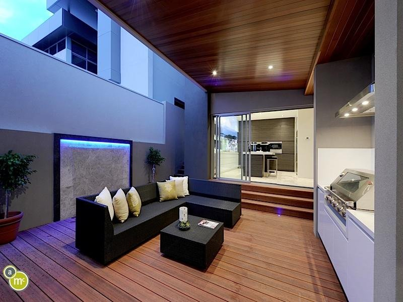 Open Plan Living Room Using Blue Colours With Hardwood