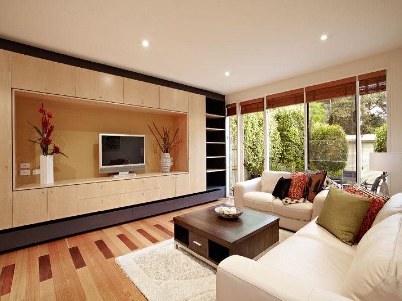 Split level living room using brown colours with for Living area interior