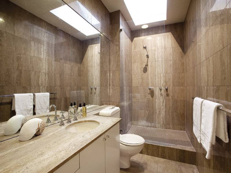Frameless glass in a bathroom design from an australian for New home bathroom ideas