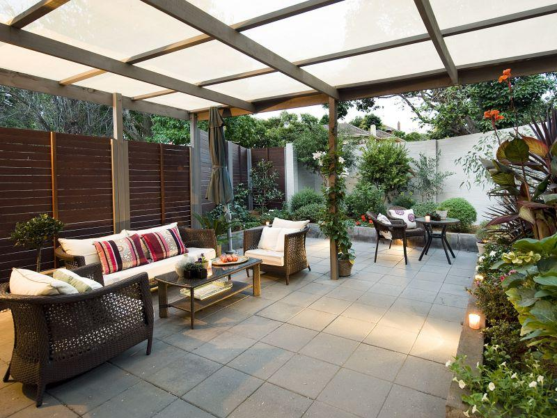 Walled outdoor living design with pergola hedging using Outdoor living areas images