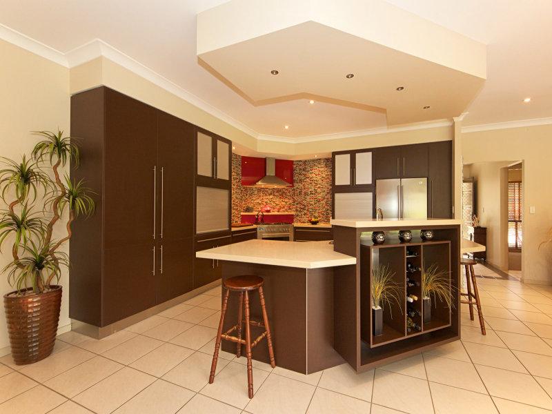 Modern island kitchen design using polished concrete - Kitchen Photo 1021571