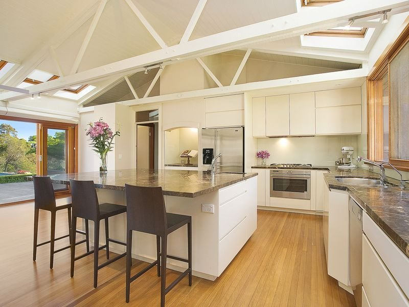 Modern island kitchen design using floorboards Kitchen