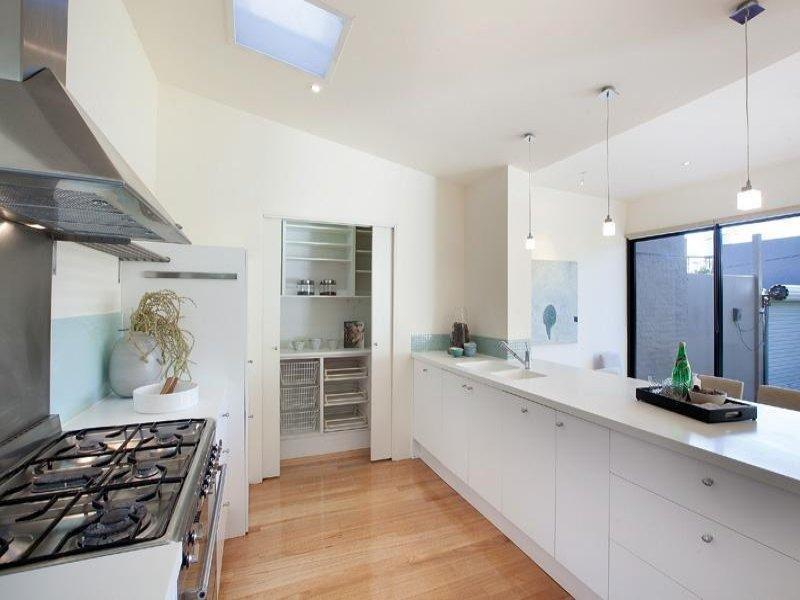 Modern galley kitchen design using floorboards kitchen for Butler kitchen designs