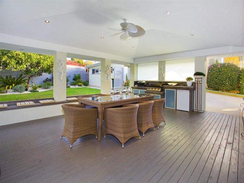 Indoor-outdoor outdoor living design with bbq area ...