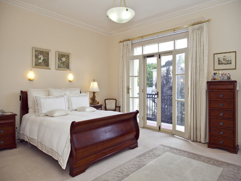 classic bedroom design idea with carpet french doors