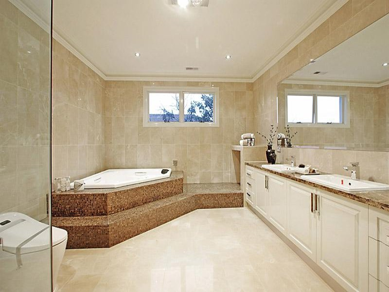 Classic bathroom design with corner bath using glass for Bathroom design pictures gallery
