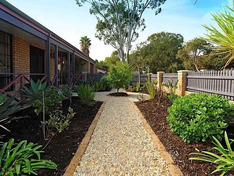 landscaped garden design using pebbles with verandah  u0026 rockery