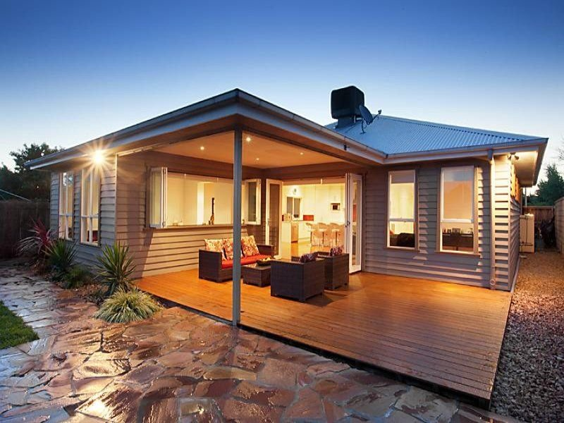Indoor-outdoor outdoor living design with outdoor dining ...