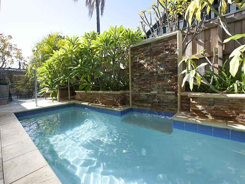 In ground pool design using tiles with retaining wall for Pool design retaining wall