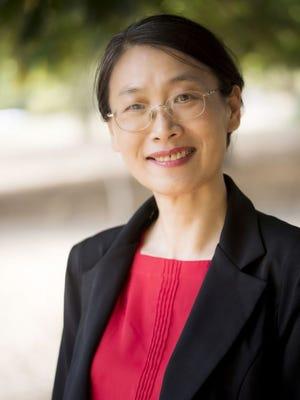Geraldine (Xiao-Bin) Wang