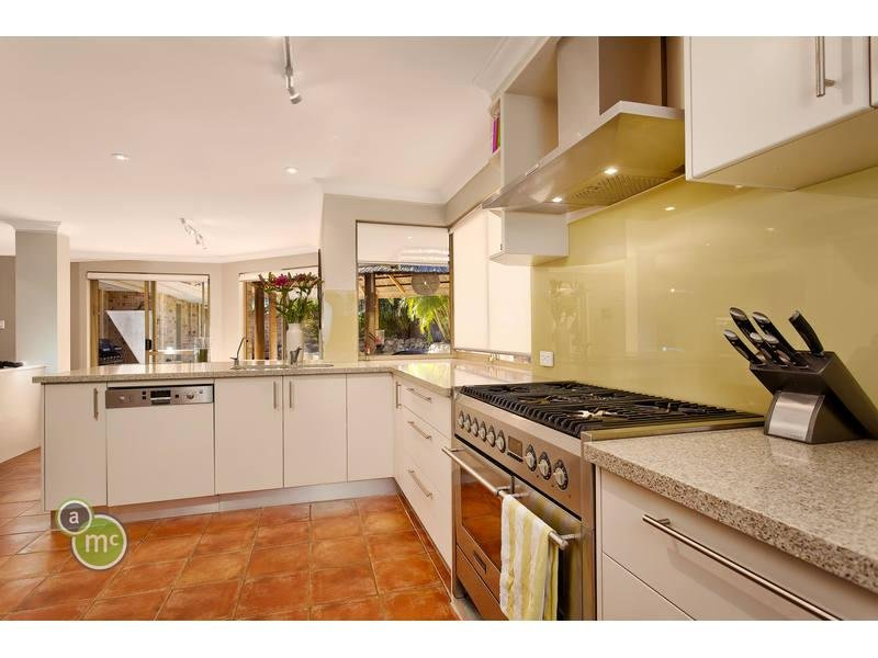 laminate flooring in the kitchen granite in a kitchen design from an australian home 8868